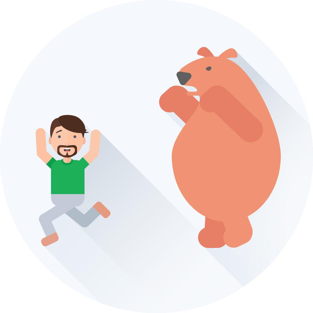 Mand der løber fra en bjørn som jagter ham